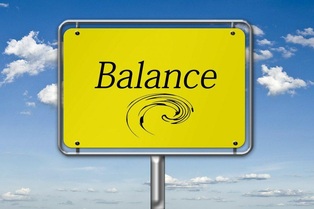 a Balance road sign